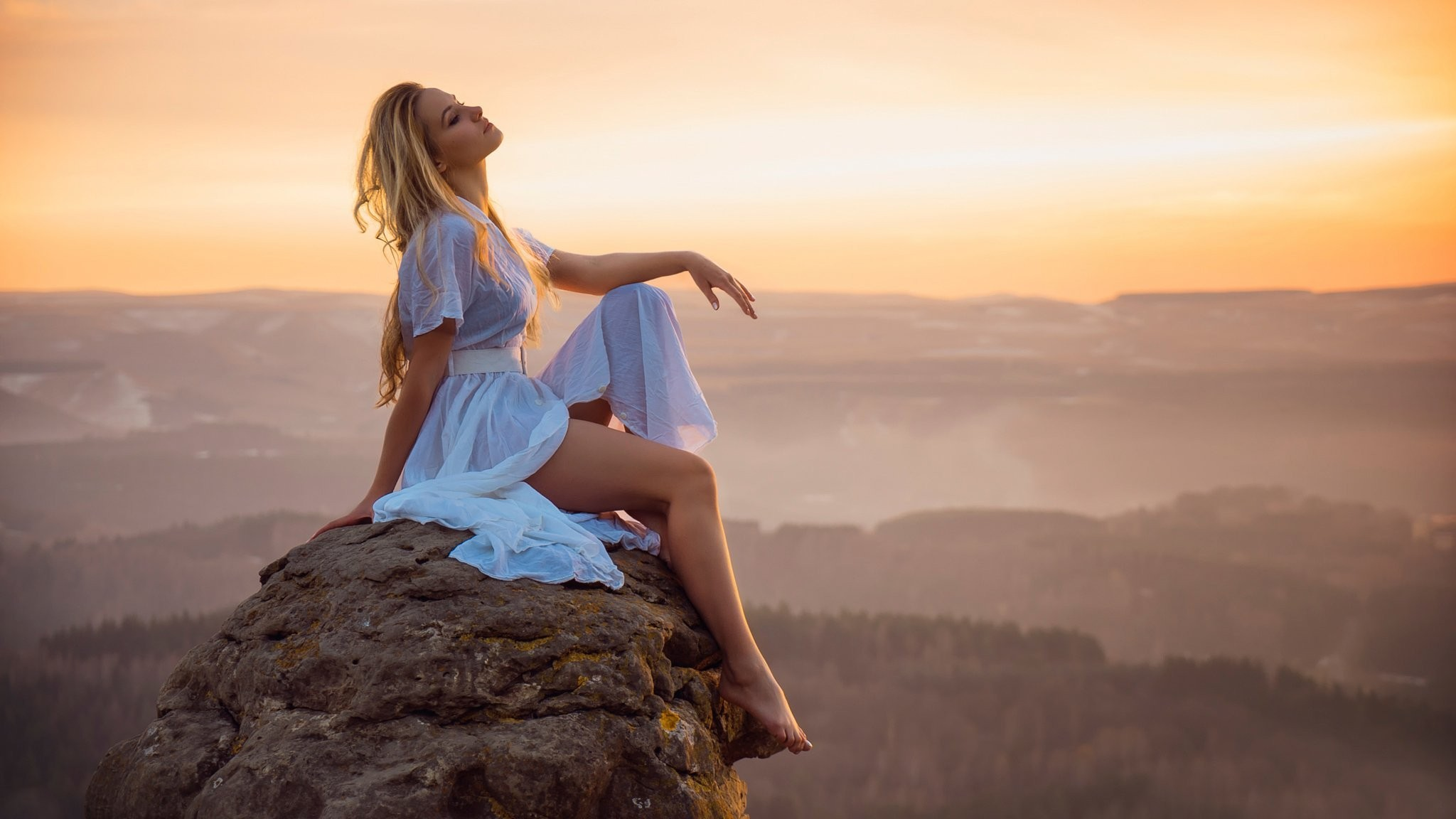 http://freshwidewallpapers.com/download/299/2048x1152/none/sunset-alone-girl-white-dress-feet-stone-height-the-distance-landscape.jpg