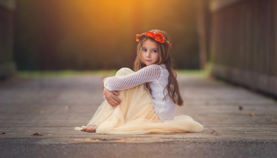 sitting girl flower crown chil…