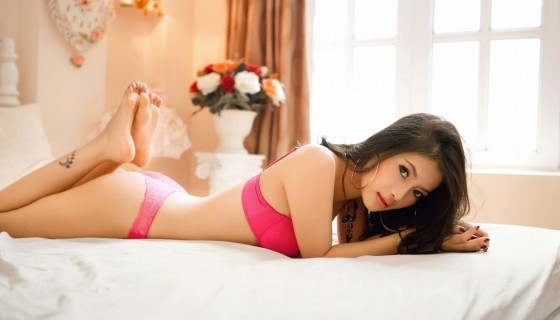 women asians lying on stomach …