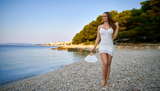 women outdoors in white dress …