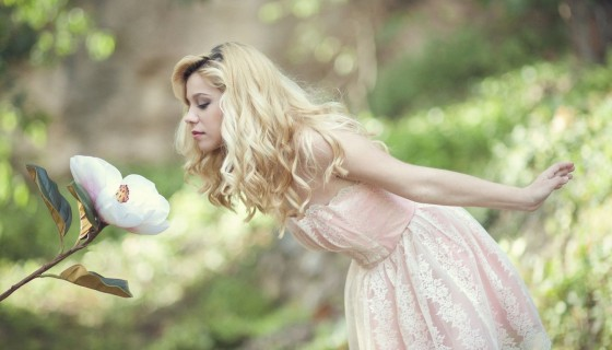Blonde Girl Smelling Flower be…